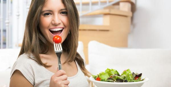 Lady eating salad